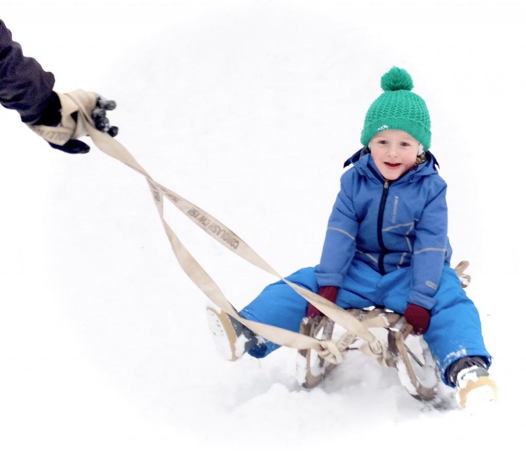 ski en slee piste met kinderen in Belgie